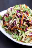 Ginger Asian coleslaw is packed with fresh flavors like ginger, peanut butter, apple cider vinegar, and cilantro! It's sweet, tangy, crunchy, and delicious as a side dish or to top burgers, sandwiches, and wraps!