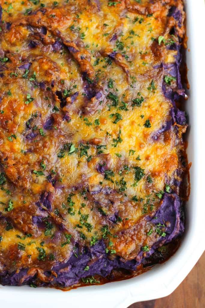 Vegetable Shepherd's pie is loaded with sauteed crimini mushrooms, chick peas, and mixed veggies. Topped with creamy purple mashed potatoes. This is our favorite fall casserole! Vegetarian.