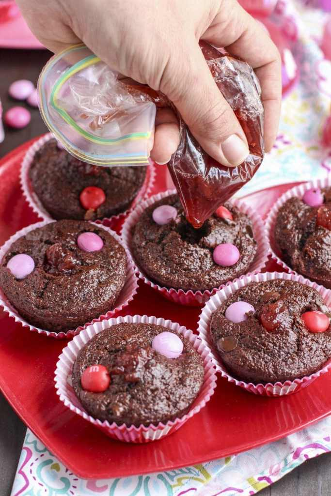 filling chocolate strawberry filled muffins_1