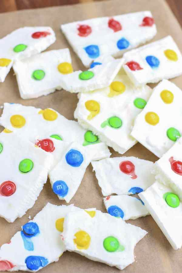 Creamy greek yogurt bark decorated with M&M's® Milk Chocolate in a design that makes it look just like a Twister game!