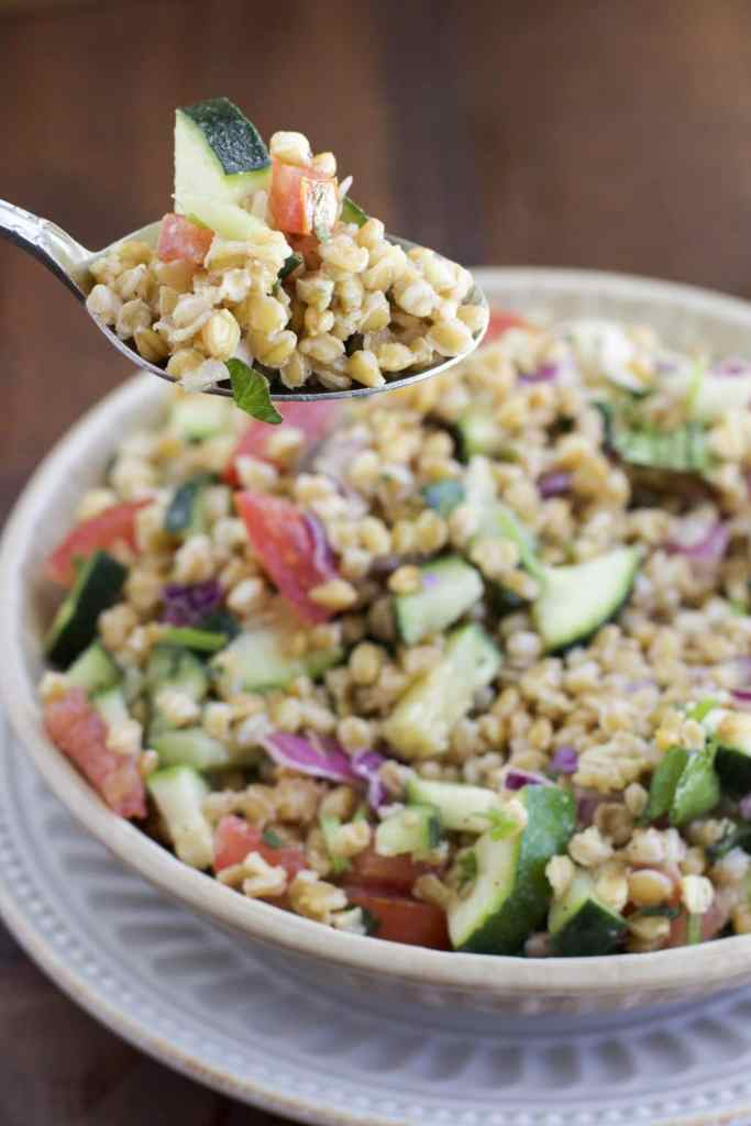 Simple Einkorn wheat berry salad that's packed with fresh herbs and flavors that make this the perfect side dish! Full of protein, antioxidants and a healthier alternative than rice.