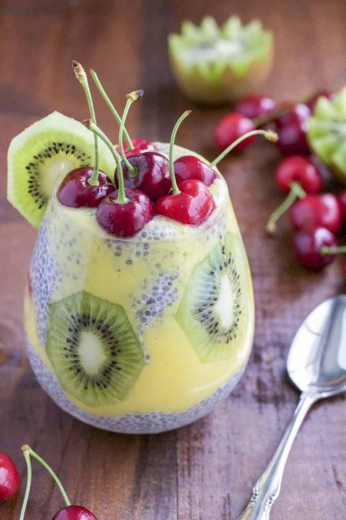 Protein and fiber rich chia seed pudding layered with sweet coconut mango puree, fresh kiwi and topped with juicy cherries. You can make this for breakfast, a snack or for dessert! Dairy-free.