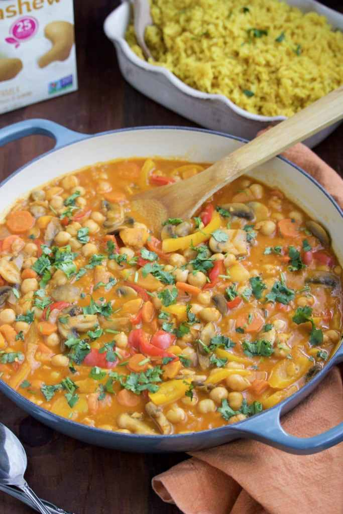 Spicy red curry chickpeas & vegetables is a healthy vegan dinner that will keep you on track with your new year's resolutions!
