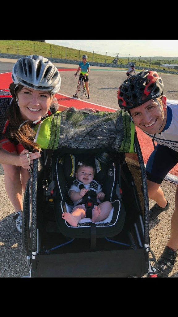 Couple with a baby in a bike trailer