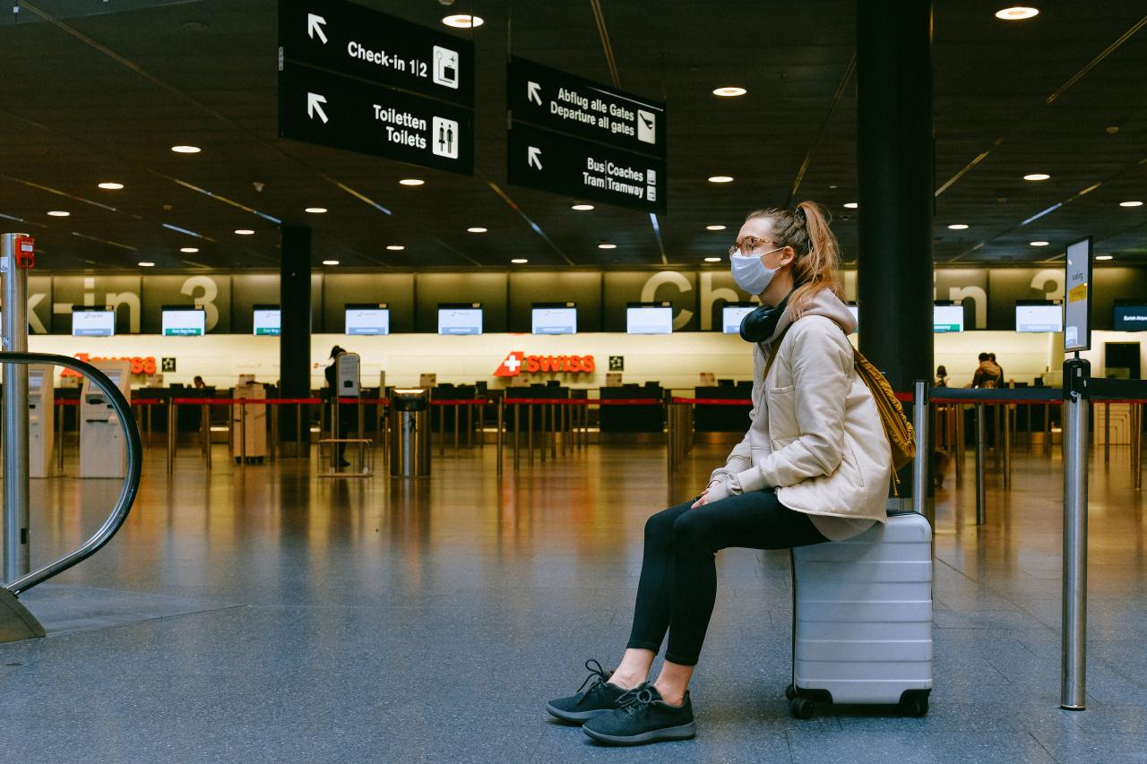 woman traveller with mask in airport