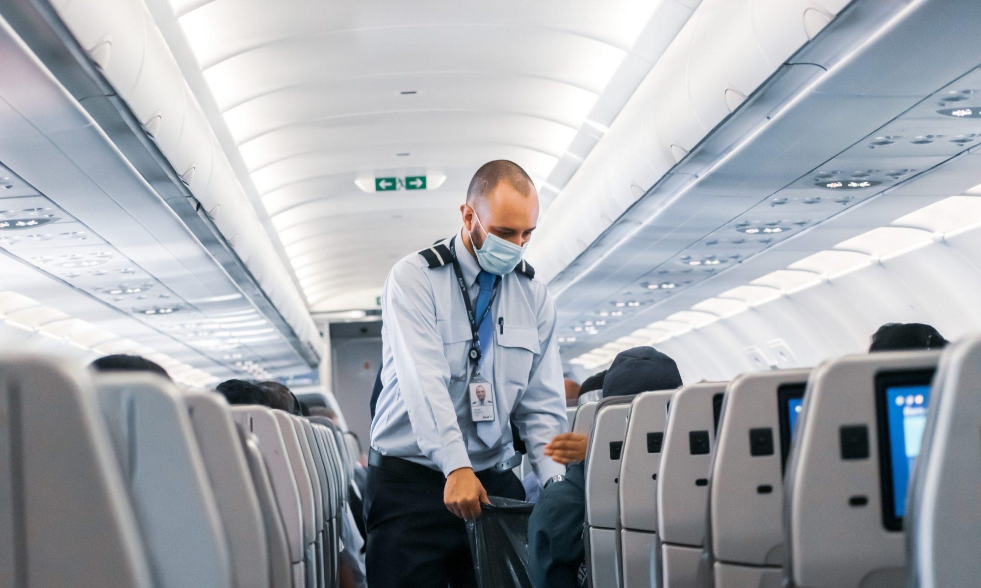 Flight attendant in cabin