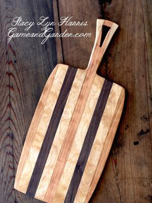 This Heirloom Hardwood Cutting Board is handcrafted cutting board is made from maple, cherry wood, and black walnut; These hardwoods are favorites for cutting boards. Hardwood with tightly grained wood and small pores are best for wooden cutting boards. The wood is hand chosen by the craftsmen for each project.