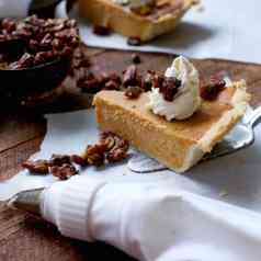 Southern sweet potato pie with fresh sweet potatoes, cream cheese whipped cream, and candied pecans