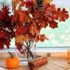 fall arrangement sticks pinecones gourds