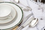 Stock image of silverware and plates.