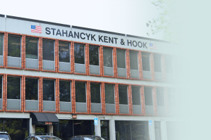 The Portland Stahancyk, Kent and Hook office building - 3 stories, red brick facade.