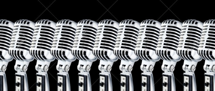670563-Lotta-Mics-Row-Of-Retro-Mics-Against-Black-Background-Design-Element--Stock-Photo