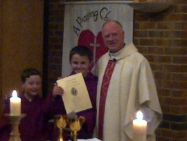 Liam was enroled in June, he renewed his promises and received his certificate. Seen here with Fr. Paul and Joseph, one of our newer servers.