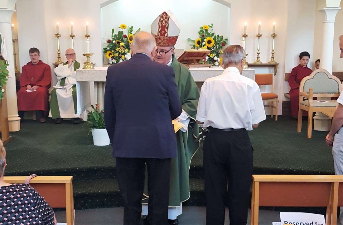 Ronnie and Peter receive their St. Hugh of Lincoln medals from Bishop Patrick
