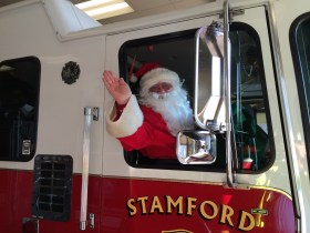 Giving Santa a lift to the kids party