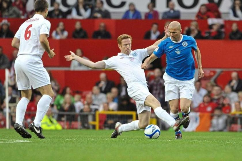 Don't break a leg: Damian Lewis in action against Zinedine Zidane at Old Trafford in 2010.