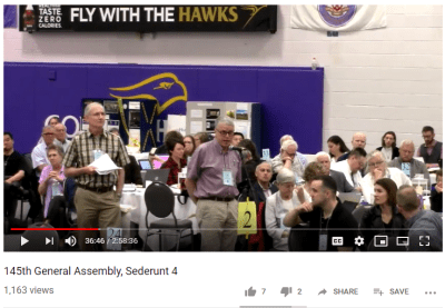 Who is that guy speaking to assembly?