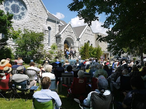 Some of the congregation that gathered for worship under the trees on a stunning sabbath morn in June.