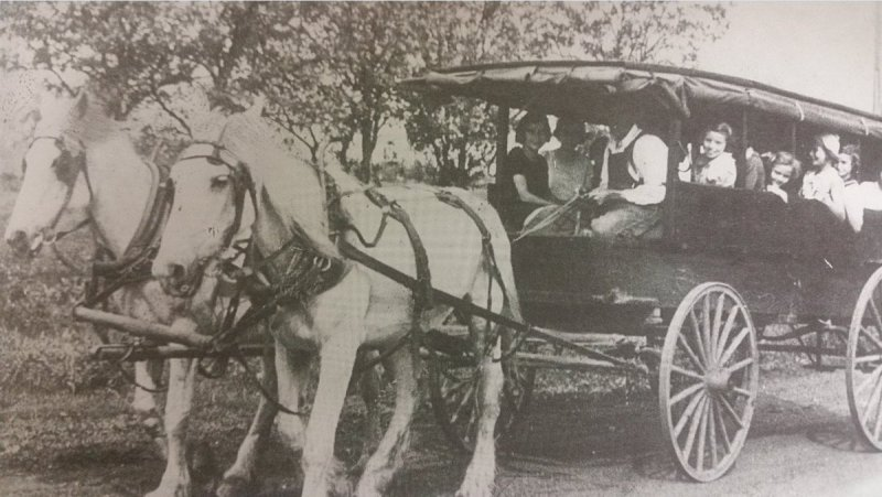 """One of two school """"buses"""" driven by Mr. Beaton at St. Andrews School. Bricks were used to keep feet"""