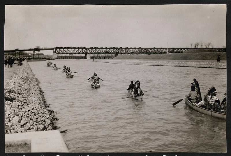 Canoes going through St. Andrews locks on way to Lower Fort Garry, Manitoba. ca 1920