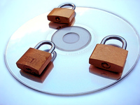 padlocks on top of a CD