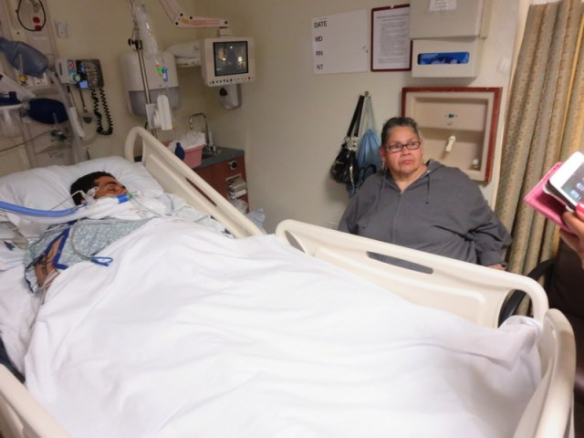 Danny Cruz lying in a coma at Methodist Hospital with his mother Mercedes.