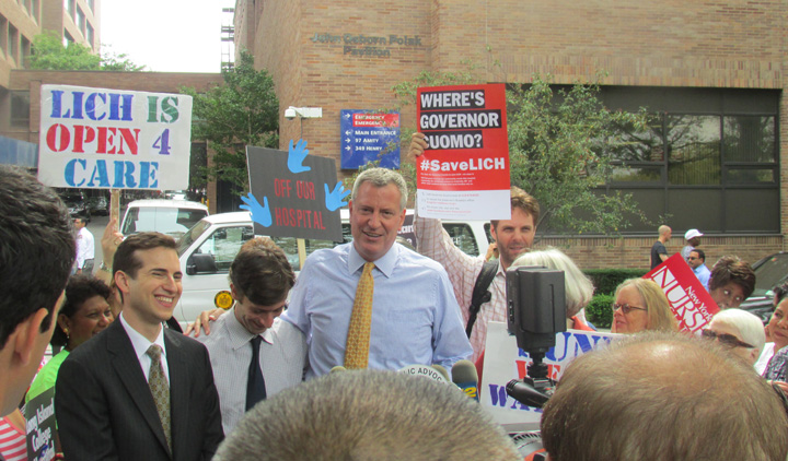 Sikora at a LICH rally last summer. He is the one holding up the big red sign.