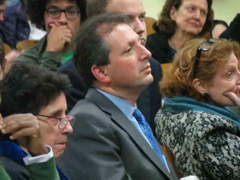 Brad sitting next to State Assembly member Jo Ann Simon.