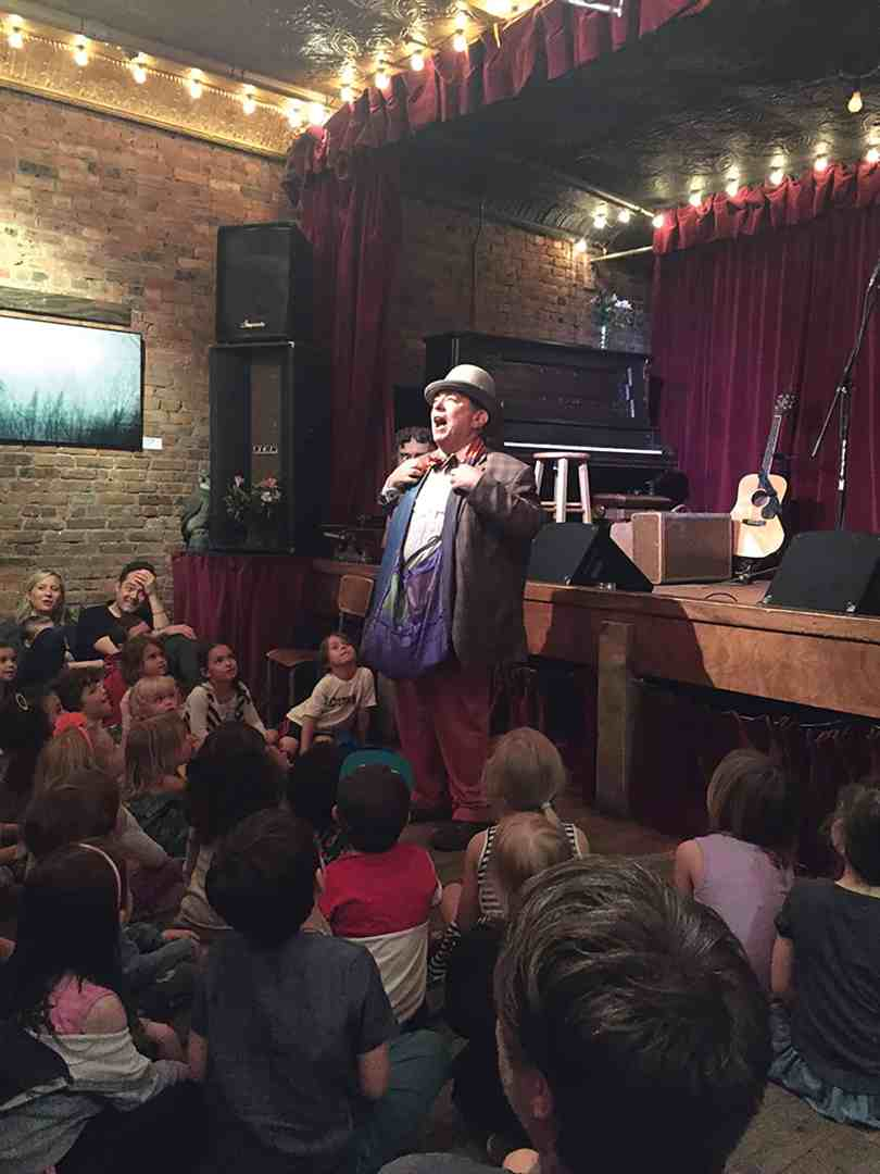 Birthday Max gets a lot of laughs from an enchanted audience at the Jalopy Theater. (photo courtesy Elizabeth Covington/twisted balloon company