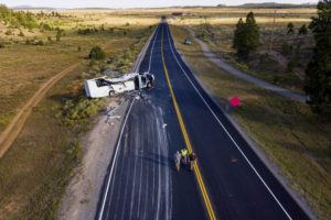 SPENSER HEAPS/THE DESERET NEWS VIA AP                                 The remains of a bus that crashed while carrying Chinese-speaking tourists lie along State Route 12 near Bryce Canyon National Park in Utah, as authorities continue to investigate.