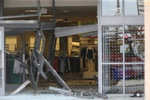 JOHN J. KIM/CHICAGO TRIBUNE VIA AP                                 The damaged storefront of the Sears store at Woodfield Mall is seen after a man drove an SUV into the store in the Chicago suburb of Schaumburg, Ill.
