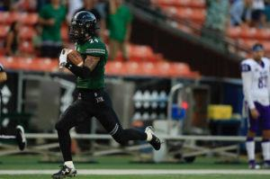 JAMM AQUINO / JAQUINO@STARADVERTISER.COM                                 University of Hawaii's Kai Kaneshiro runs back interception for a touchdown in tonight's game at Aloha Stadium.