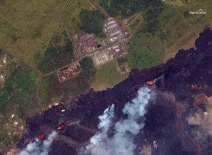 ASSOCIATED PRESS VIA DIGITALGLOBE                                 This satellite photo provided by DigitalGlobe shows lava from Kilauea fissures approaching the Puna Geothermal Venture energy plant in Pahoa on May 23, 2018.