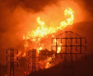 ASSOCIATED PRESS                                 In this Dec. 16, 2017, photo provided by the Santa Barbara County Fire Department, flames burn near power lines in Sycamore Canyon near West Mountain Drive in Montecito, Calif.