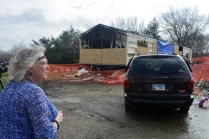 THE PANTAGRAPH VIA ASSOCIATED PRESS / APRIL 7, 2019                                 Marie Chockley, a resident of the Timberline Trailer Court, north of Goodfield, Ill., surveys the damage that was caused by a night fire that killed five residents in a mobile home.