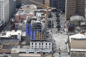 ASSOCIATED PRESS The Hard Rock Hotel, which was under construction, after a fatal partial collapse in New Orleans on Saturday.