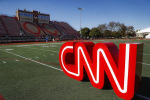ASSOCIATED PRESS                                 A CNN sign rests on an athletic field outside the Clements Recreation Center where the CNN/New York Times will host the Democratic presidential primary debate at Otterbein University, Monday in Westerville, Ohio.