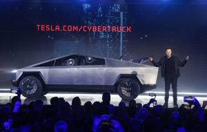 ASSOCIATED PRESS                                 Tesla CEO Elon Musk introduces the Cybertruck at Tesla's design studio today in Hawthorne, Calif. Musk is taking on the workhorse heavy pickup truck market with his latest electric vehicle.