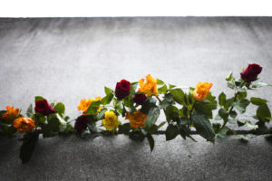 ASSOCIATED PRESS                                 Flowers stuck in remains of the Berlin Wall during a commemoration ceremony to celebrate the 30th anniversary of the fall of the Berlin Wall at the Wall memorial site at Bernauer Strasse in Berlin.