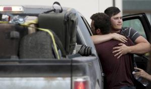 ARIZONA DAILY STAR VIA AP                                 Cole Langford, left, and Hayden Spenct, of the Mormon colony in La Mora, Mexico, hug at a gas station in Douglas, Ariz., today.