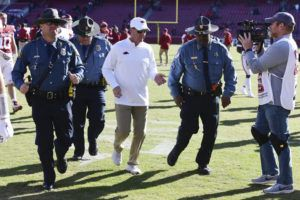 ASSOCIATED PRESS                                 Arkansas coach Chad Morris heads to the locker room after the Razorbacks' 45-19 loss to Western Kentucky in an NCAA college football game on Saturday in Fayetteville, Ark.