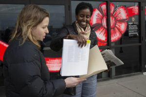 MINNESOTA PUBLIC RADIO VIA AP                                 Mary Blitzer, left, of the Sierra Club, gives a petition of more than 23,000 signatures to Amira Adawe of the Beautywell Project as they deliver it to the Amazon Fulfillment Center in Shakopee, Minn. The two nonprofit groups launched a campaign for Amazon and E-bay to stop selling toxic skin-lightening creams that contain mercury.
