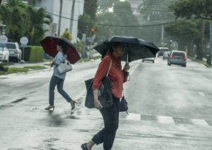 STAR-ADVERTISER / NOV. 22                                 People walked in the rain in Makiki. Clouds and showers are forecast for Christmas Eve over Kauai and Oahu, according to forecasters, with scattered showers expected to spread to the eastern isles on Christmas Day.