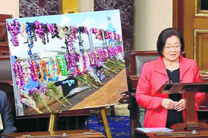 COURTESY MAZIE HIRONO                                 Mazie Hirono pays tribute to Pearl Harbor shipyard shooting victims.