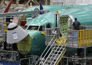 ASSOCIATED PRESS / March 27                                 A worker enters a Boeing 737 MAX 8 airplane during a brief media tour of Boeing's 737 assembly facility in Renton, Wash., in March.