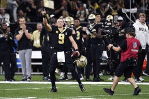 ASSOCIATED PRESS                                 New Orleans Saints quarterback Drew Brees (9) celebrated his touchdown pass to tight end Josh Hill, which broke the NFL record for career touchdown passes, surpassing Peyton Manning, in the second half against the Indianapolis Colts in New Orleans, today.