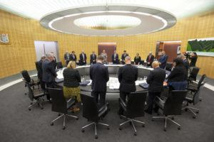 POOL PHOTO VIA AP                                 New Zealand Prime Minister Jacinda Ardern and her cabinet observe a moment of silence on Monday.