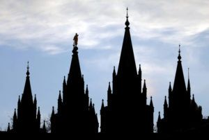 ASSOCIATED PRESS                                 The angel Moroni statue, silhouetted against the sky, sat atop the Salt Lake Temple of The Church of Jesus Christ of Latter-day Saints, , in Jan. 2018, at Temple Square, in Salt Lake City. The Church of Jesus Christ of Latter-day Saints, today, defended how it uses and invests member donations after a former church employee charged in a complaint to the Internal Revenue Service that the faith had improperly built a $100 billion investment portfolio using member donations that are supposed to go to charitable causes.