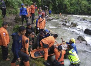 BASARNAS VIA ASSOCIATED PRESS                                 Rescuers removed the body of a victim of a bus accident in Pagaralam, Indonesia, Tuesday. A number of people were killed when the passenger bus plunged into the ravine on Sumatra island after its brakes apparently malfunctioned, police said Tuesday.
