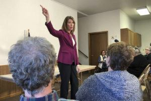 ASSOCIATED PRESS                                 Rep. Cindy Axne, D-Iowa., spoke to constituents, Saturday, about her vote on the USMCA trade deal in Guthrie Center, Iowa. Axne, who represents a district Donald Trump won in 2016, has been targeted by Republicans for her support of the impeachment proceedings, but at the town hall, none of her constituents raised her vote against the president.